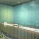 foto de sala de reuniao cercada por privacy glass esverdeado